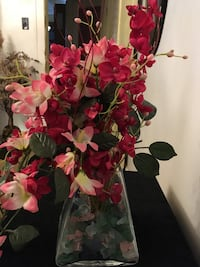 Red and pink floral arrangement accented with green & pink rocks to give it character . Chicago, 60619