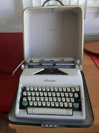 Olympia manual typewriter with case.