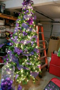 green Christmas tree with purple baubles El Paso, 79936