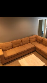 brown fabric sectional sofa with throw pillows 556 km