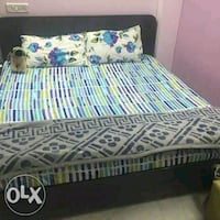 white, blue, and green floral bed sheet Delhi, 110052