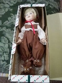 porcelain doll wearing brown overall pants with white box Kansas City, 64134