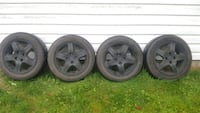 four black 5-spoke vehicle wheels and tires 3690 km