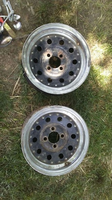 two black-and-gray 4-lugs auto wheels