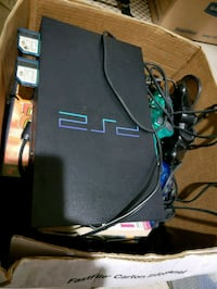 Playstation 2 plus 3 controllers and games Rockville, 20852