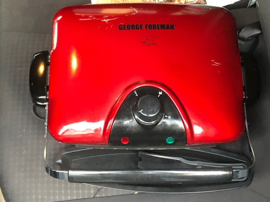 red and black George Foreman grilling machine for sale  Clemmons