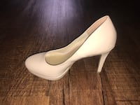 pair of white leather platform stilettos Hamilton, L8R 1C3