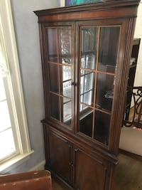 Corner cabinet. Mahogany. Three (3) top shelves glass doors(2) shelves beliw wood doors Clifton, 20124