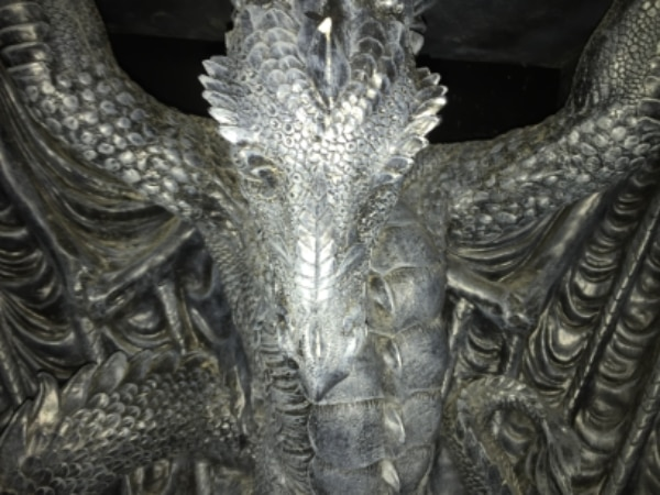 Wood and plaster carved dragon podeom