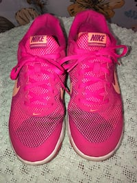 Pair of pink nike running shoes Charlotte, 28214