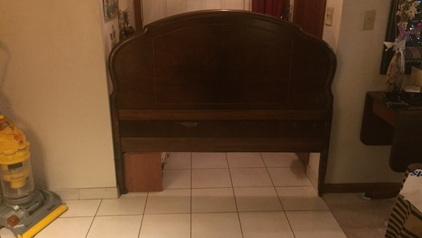 Antique wooden headboard and footboard