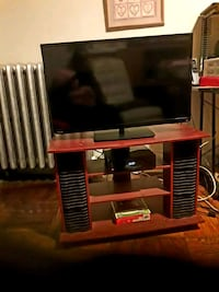 black flat screen TV and brown wooden TV stand Yonkers, 10705