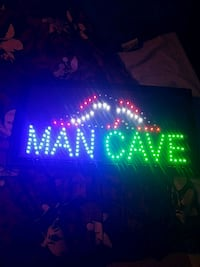 MAN CAVE sign and 8 ball clock