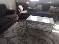 White, silver, grey coffee table and both area rugs for $350 503 km