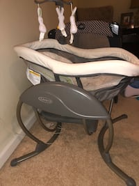 baby's black and white cradle and swing