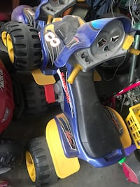 black and blue ride on toy ATV