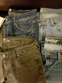 two blue and one black denim bottoms Rialto, 92377