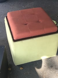 Square green and brown ottoman on four wheels