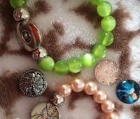 two green and white beaded bracelets