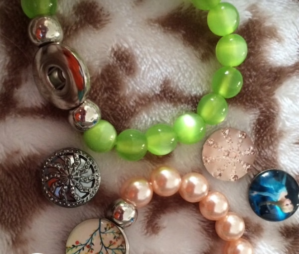two green and white beaded bracelets 48bea250-3348-429e-a4ec-d01c2769f6f4