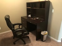 black wooden desk with rolling chair Edmonton, T6R 0N7