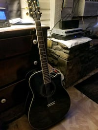 Acoustic electric Takamine guitar