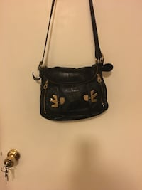 Marc Jacobs leather w/7 or more compartments great looking