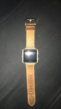 square silver analog watch with gold link bracelet