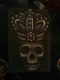 black and gray skull wearing crown painting