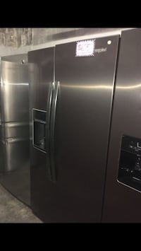 New Whirlpool Side by Side Fridge (scratched and dented) Baltimore, 21223