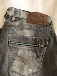 Men's Guess jeans size 33 gray