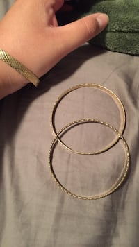 gold-colored bracelets