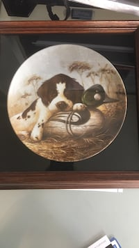 white and black dog lying down on gray and green wooden duck figurine print decorative plate box Vancouver, V6B