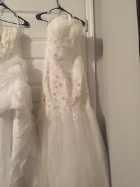 Two white wedding gowns Thompson's Station