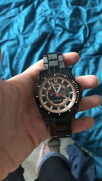 round black chronograph watch with link bracelet Fort Myers, 33905
