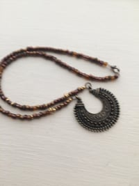 brown and black necklace with pendant Henrico, 23228