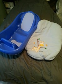 Baby bathtub and winter snuggie for car seat.