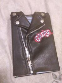 BRAND NEW GREASE with leathers coat
