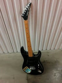 black and brown electric guitar New York, 10038