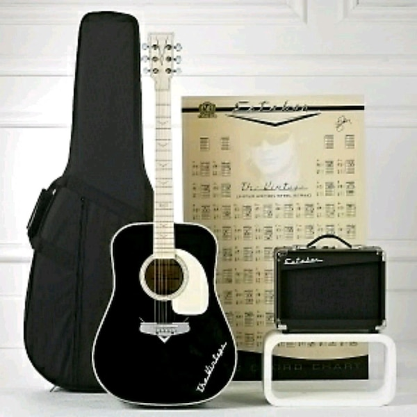 Black classical guitar with gig bag & amp.