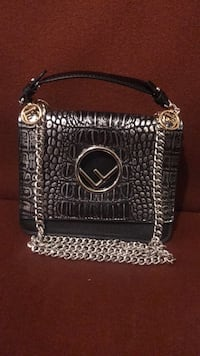Silver and black leather sling bag Richmond, V7E 1S6