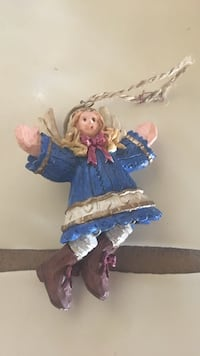 female in blue dress wood carved hanging decor