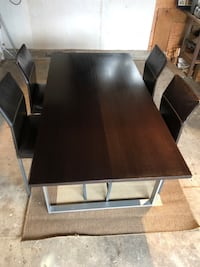 Dining Room Table with 4 genuine leather chairs and one leaf