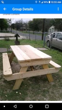 brown wooden picnic table and bench
