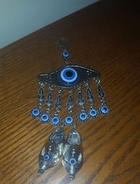 silver-colored and blue eye pendant Lincoln, L0R