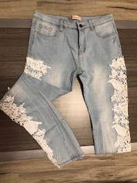 Light blue jean pants with lace