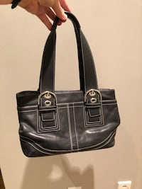 Coach black leather handbag with silver hardware and buckles Toronto, M4R 1K2