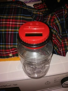 clear glass jar with red plasticl id