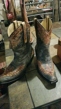 pair of brown leather cowboy boots Houston, 77078