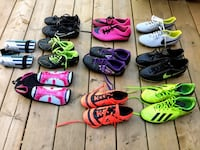 9 pairs of youth soccer shoes and shin guards